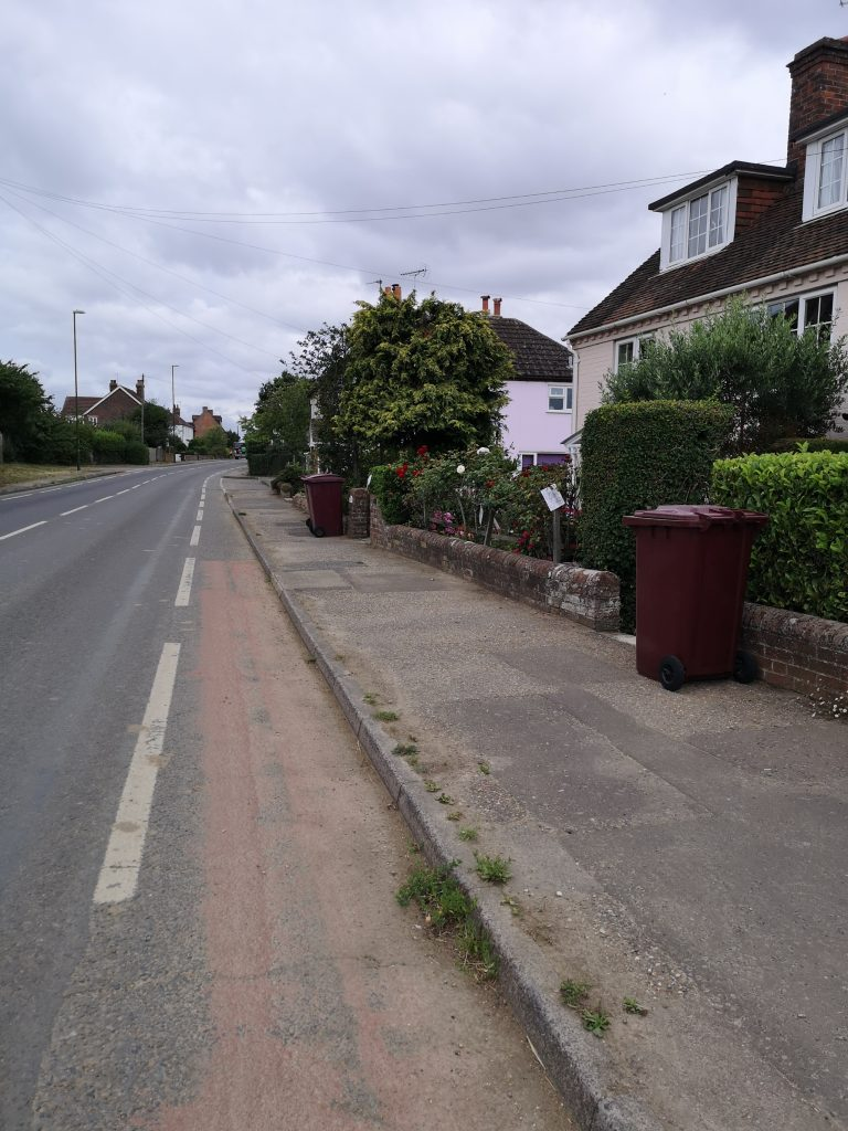 Narrow path with bins out